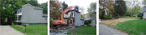 A two story house that is being demolished.